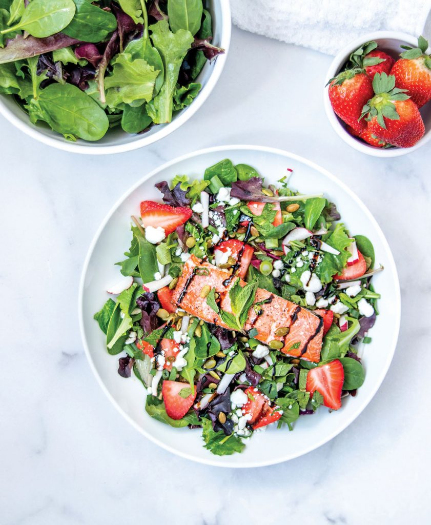 Salmon salad on a plate with strawberries